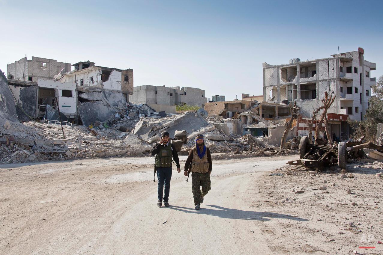 APTOPIX Mideast Syria Inside Kobani