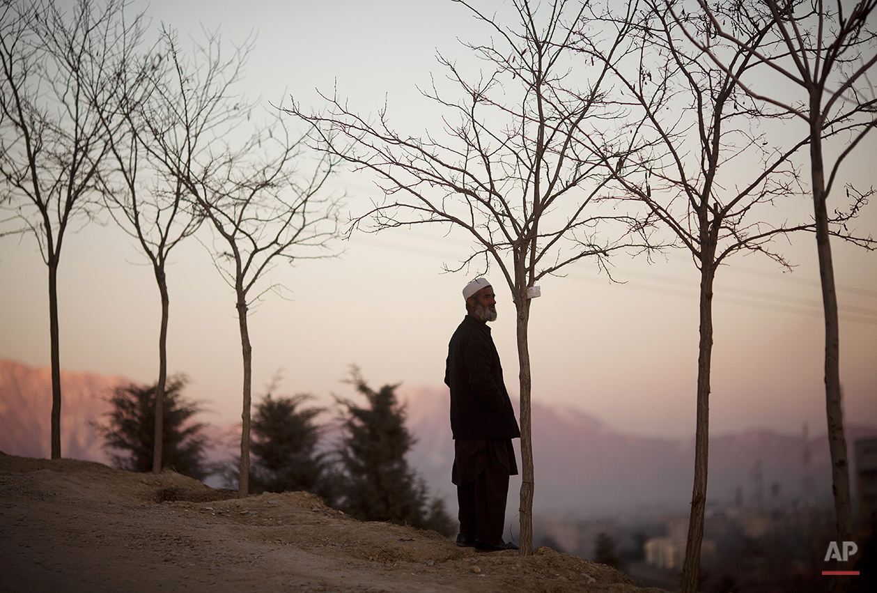 An Afghan man enjoys the view at sunset from a hill overlooking Kabul, Afghanistan,  Thursday, March 8, 2012.  (AP Photo/Anja Niedringhaus)