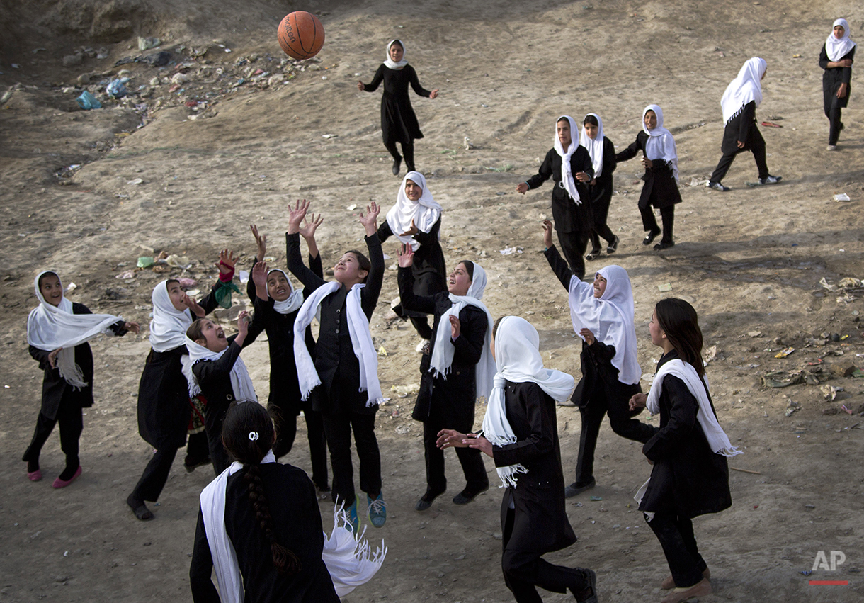 Afghani schoolgirls play volleyball with a basketball during a break at their girls school in the old town of Kabul, Sunday, April 7, 2013. In the past twelve years many girls have returned to school in Afghanistan while under Taliban rule girls where banned from attending school. (AP Photo/Anja Niedringhaus)