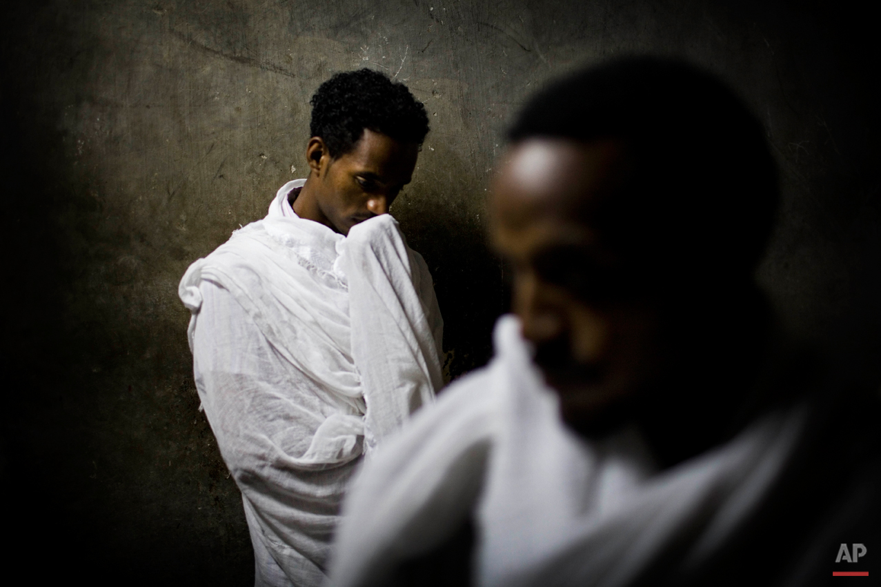 Ethiopian Orthodox Christian pilgrims pray inside the Church of the Holy Sepulcher, traditionally believed to be the site of the crucifixion of Jesus Christ, during the Eastern Orthodox Easter week in Jerusalem's Old City, Wednesday, March 31, 2010. Christians from around the world are in the Holy Land marking the solemn period of Easter. (AP Photo/Bernat Armangue)