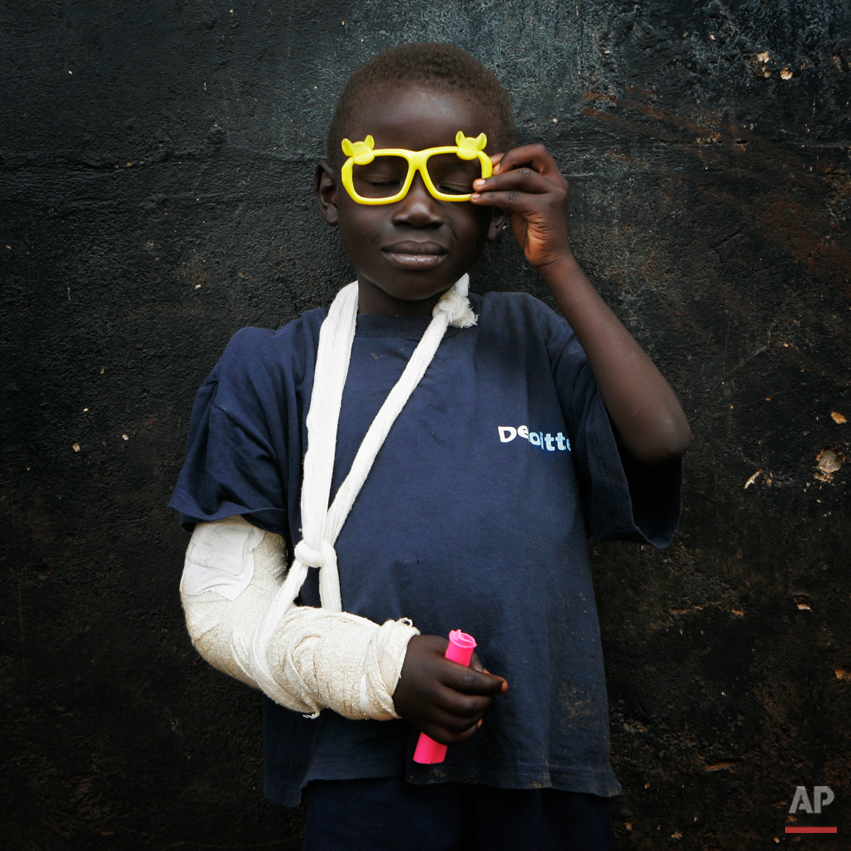 """Glen Amadi, 6, poses in an orphanage on the outskirts of Nairobi, Kenya, Friday Feb. 15, 2008. Amadi says he can't remember where he lives. His mother's name is Eliza, he says, and she braids hair in a salon run by a woman he calls """"Mama Dana."""" All the orphanage workers know is that he was found at a nearby camp for displaced families. Waves of ethnic and political attacks since Kenya's disputed Dec. 27 election have uprooted more than half a million people. In the chaos, parents and children lost track of each other. In addition to more than 1,000 people killed, about 400 children were found alone, without adults.  (AP Photo/Bernat Armangue)"""