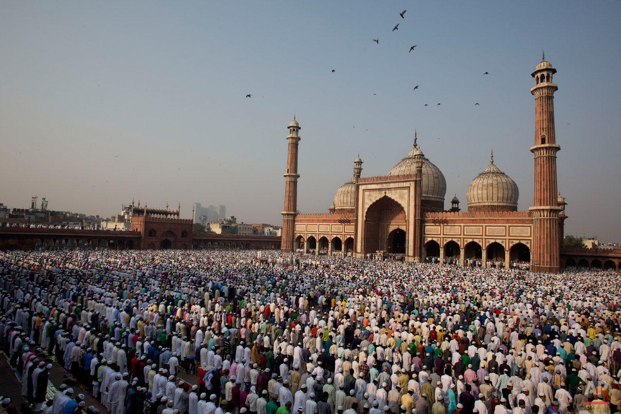 Indian Muslims offer prayers to mark the festival of Eid al-Adha at Jama Masjid in New Delhi, India, Monday, Oct. 6, 2014. Muslims in the country celebrate Eid al-Adha, or the Feast of the Sacrifice, by slaughtering sheep, goats and cows. (AP Photo/Bernat Armangue)