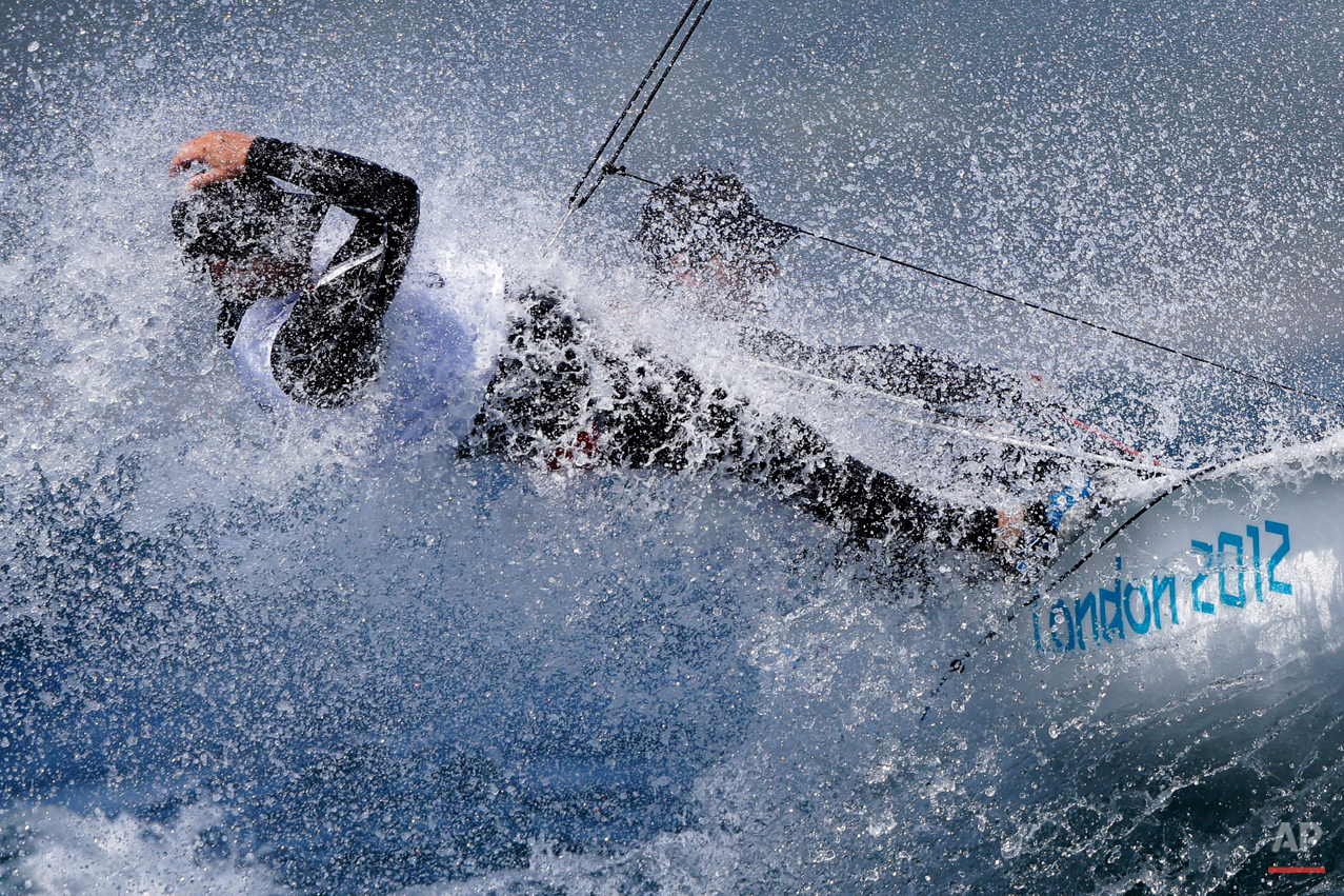 USA's Stuart McNay and Graham Biehl, foreground, compete during the 470 class race at the London 2012 Summer Olympics, Thursday, Aug. 2, 2012, in Weymouth and Portland, England. (AP Photo/Bernat Armangue)