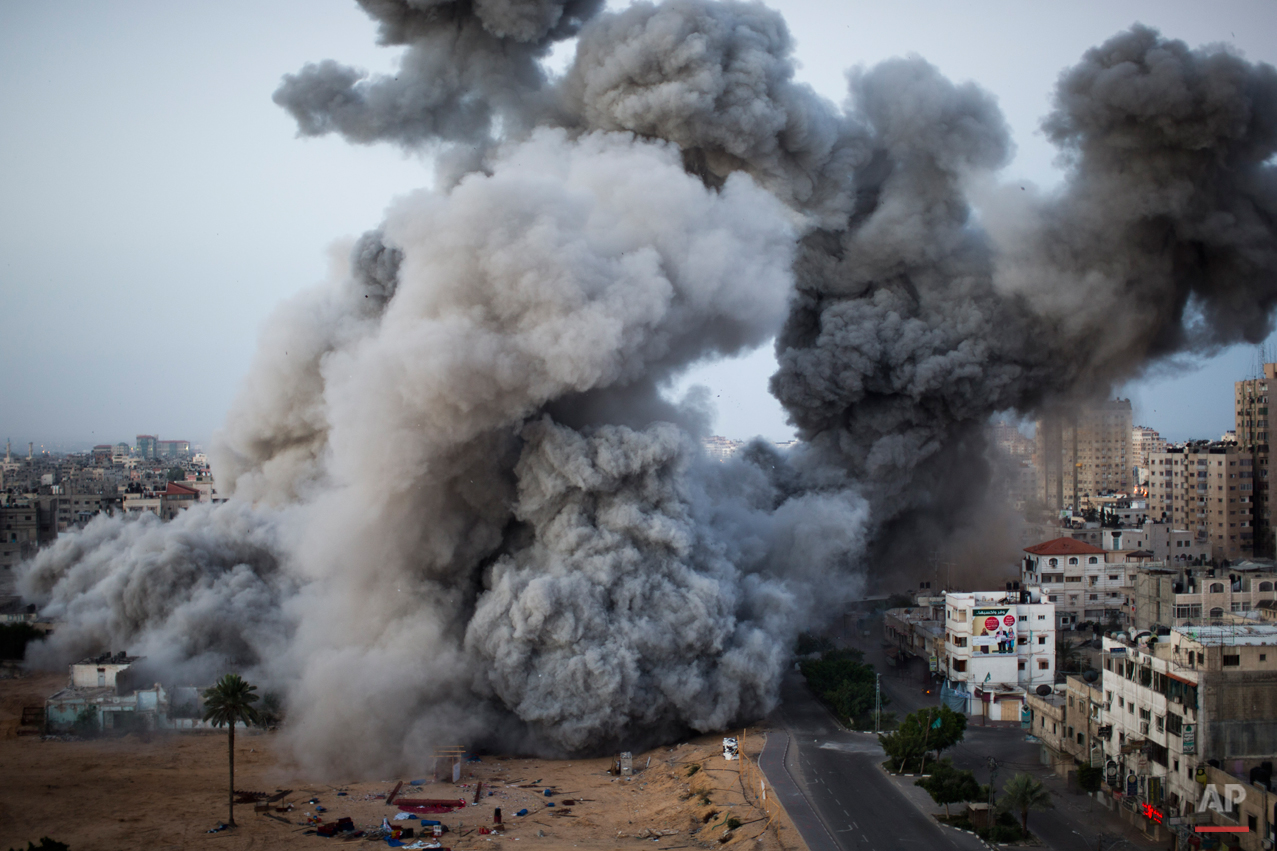 Smoke rises after an Israeli forces strike in Gaza City, Sunday, Nov. 18, 2012. The Israeli military widened its range of targets in the Gaza Strip on Sunday to include the media operations of the Palestinian territory's Hamas rulers, sending its aircraft to attack two buildings used by both Hamas and foreign media outlets. (AP Photo/Bernat Armangue)