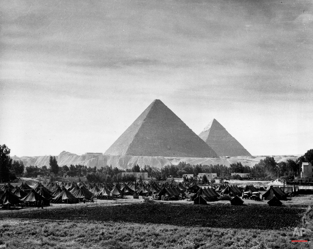 The pyramids of Egypt are contrasted against the pyramidal tents of an army camp set up near Mena House to provide quarters for military police and other military personnel necessary at the Cairo Conference in Nov. 1943.  The World War II meeting between leaders of the Three Great Allies, U.S.A., Great Britian and China, takes place Nov. 23-26.  (AP Photo)