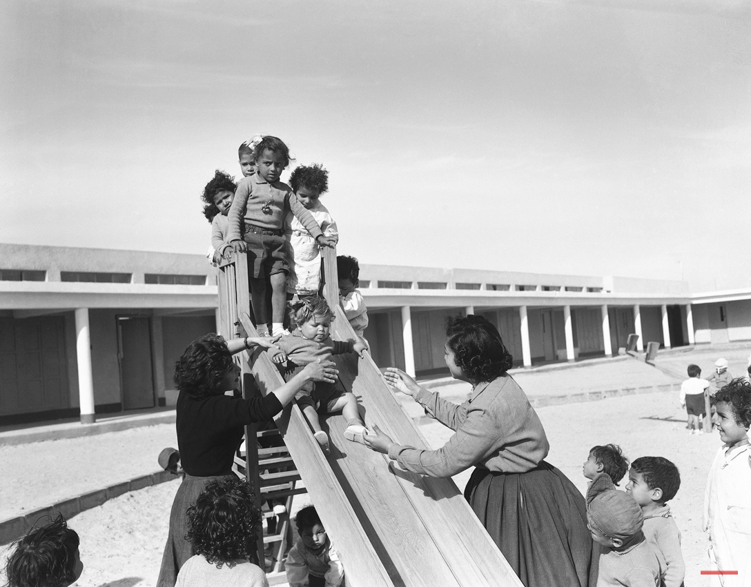Young Egyptian peasant children play during a mid-day break, on the ground of the new school at Egyptís new farm project in El Tahrir province, Cairo on May 14, 1956. A nurse and teacher supervise the play. (AP Photo/Jim Pringle