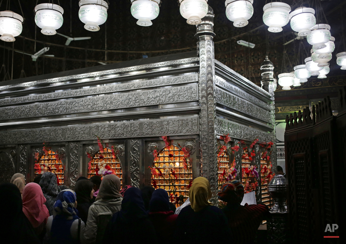 Egyptian women chant a day before Moulid, which commemorates the birth of Prophet Muhammed, the central figure of the Islamic religion, at a mosque in Cairo, Egypt, Friday, Jan. 2, 2015. Every year, Egyptians celebrate Moulid by performing ritual dances, prayers and spending time with their families. (AP Photo/Nariman El-Mofty)