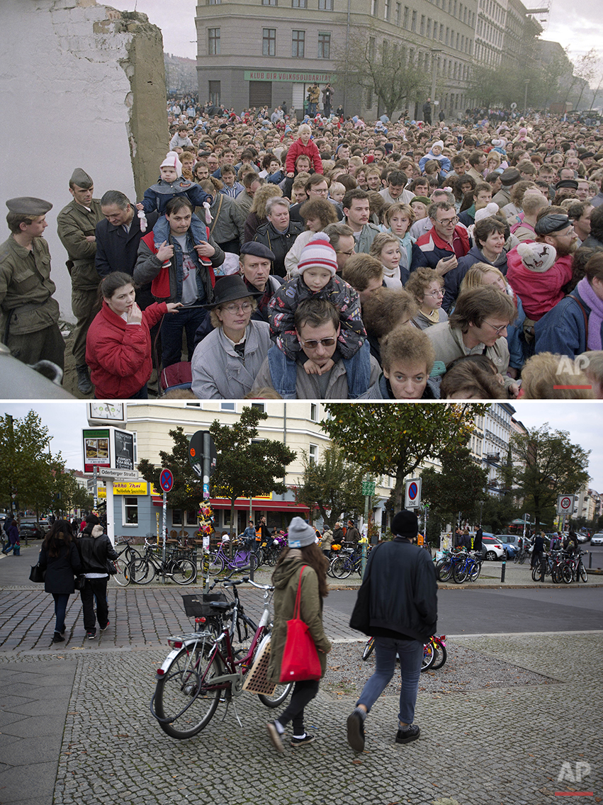 The combo shows east Berlin citizens crowding the new passage at Bernauer Strasse in Berlin where East German border police tore down segments of the wall on Nov. 11, 1989 and  people walking at the crossing Bernauer Strasse and Oderberger Strasse on Oct. 26, 2014 - 25 years after the fall of the wall. (AP Photos/Rudi Blaha, Markus Schreiber)