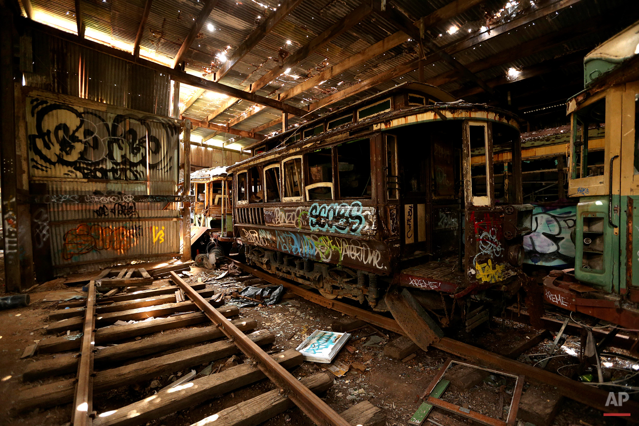 In this Oct. 22, 2014 photo, old tramcars and trolley buses sit abandoned and wrecked in the Loftus Tram Shed in Sydney. Trams became a key part of life in Sydney after the network was installed in 1879, with 1,600 cars in service during the height of its popularity. The service was eventually shut down in 1961. (AP Photo/Rob Griffith)