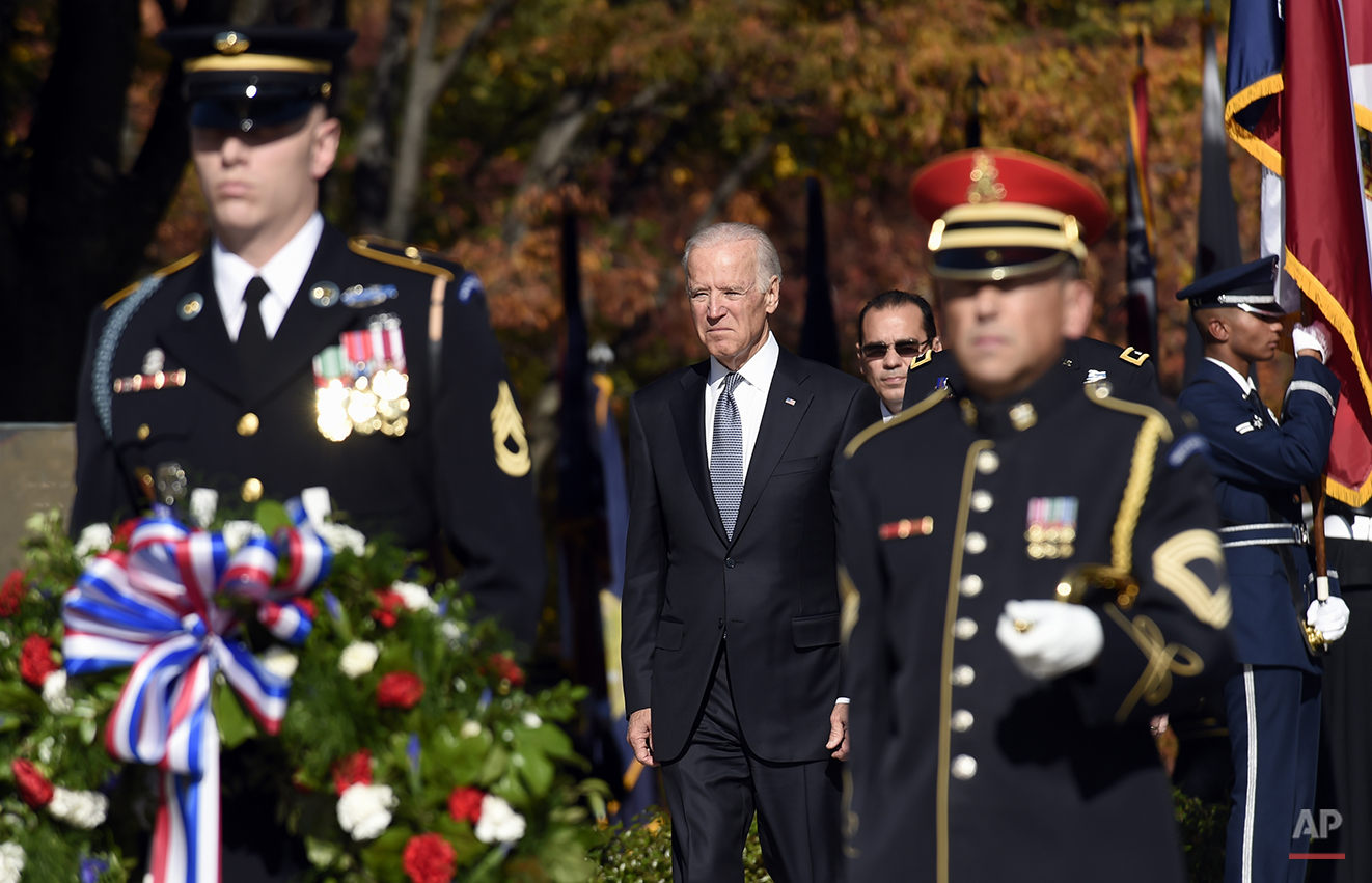 Vice President Joe Biden arrives to lay a wreath at the Tomb of the Unknowns, Tuesday, Nov. 11, 2014, at Arlington National Cemetery in Arlington, Va. in honor of Veterans Day. Americans marked Veterans Day on Tuesday with parades, speeches and military discounts, while in Europe the holiday known as Armistice Day held special meaning in the centennial year of the start of World War I.  (AP Photo/Susan Walsh)