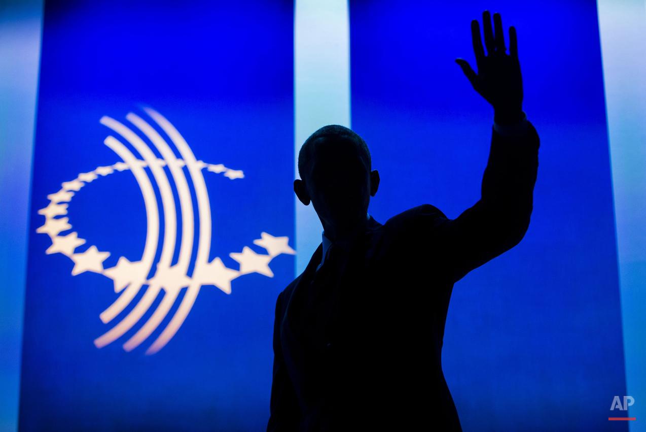 APTOPIX Obama Clinton