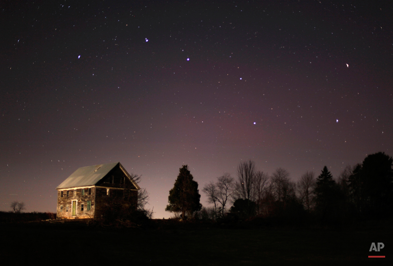 In this Nov. 11, 2010 photo, the big dipper shines in the evening sky over a 212-year-old farm house in Brunswick, Maine. (AP Photo/Robert F. Bukaty)