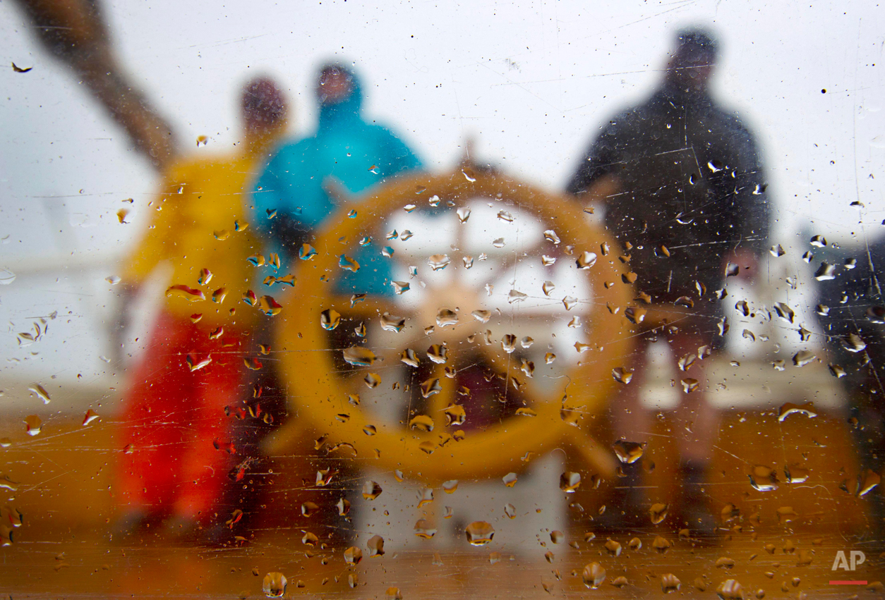 In this photo made Saturday, May 25, 2013, rain drops splatter a window on the schooner Mary Day during a cruise off the coast near Camden, Maine. Foul weather that started the holiday weekend moved out on Sunday, giving passengers a full taste of what Maine has to offer. (AP Photo/Robert F. Bukaty)