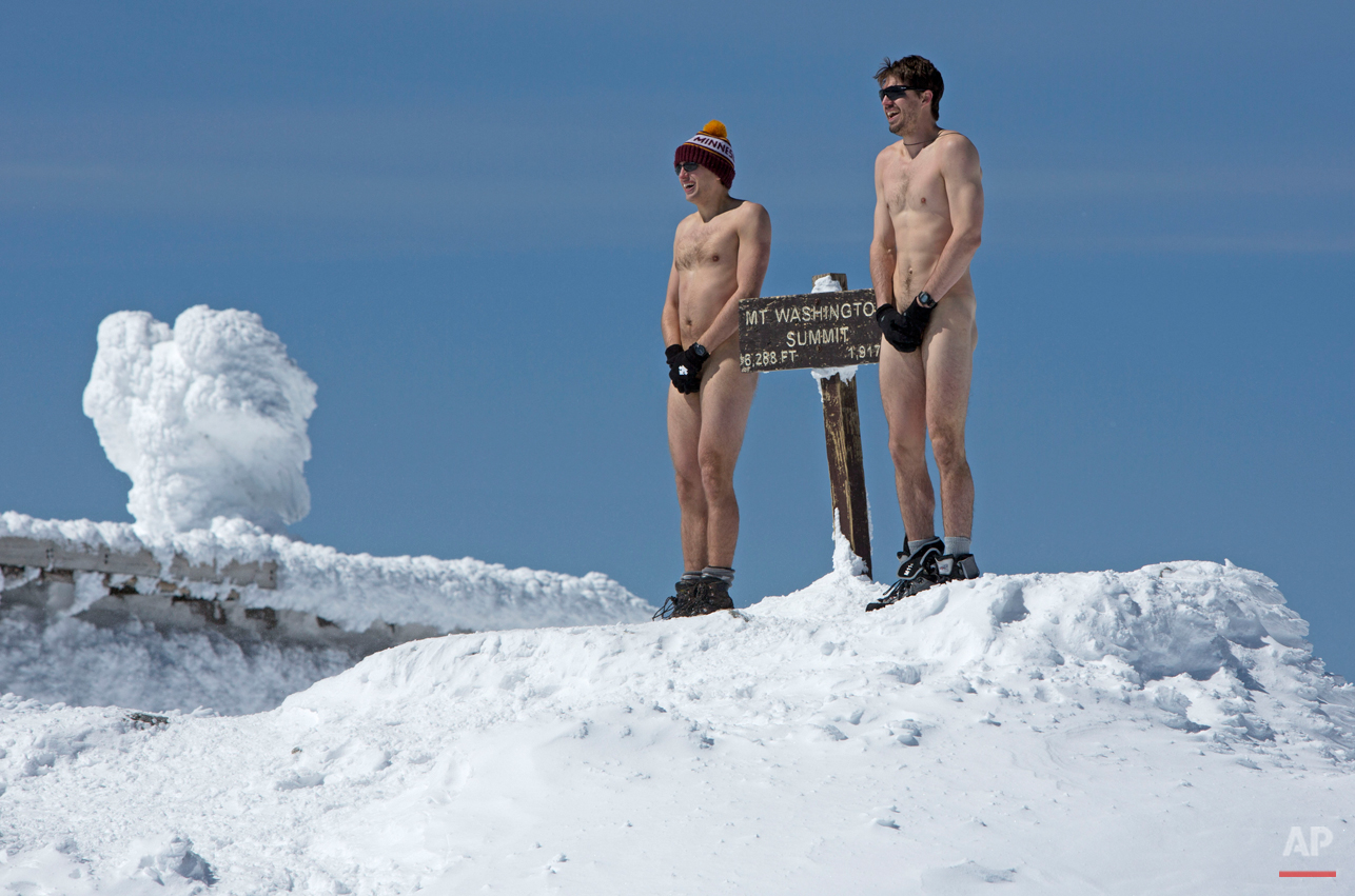 A pair of hikers brave 17 degree Fahrenheit temperatures at the summit of 6,288-foot Mt. Washington, Saturday, March 30, 2013, in New Hampshire. The duo, medical students at Columbia University, shed their clothes to streak the final 50 yards to the summit. (AP Photo/Robert F. Bukaty)