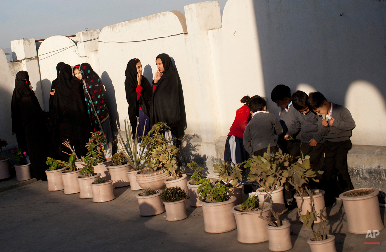 In this Thursday, Nov. 15, 2012 photo, Pakistani school children gather at the patio of the Khushal School for Girls in Mingora, Swat Valley, Pakistan. Malala Yousafzai's struggle for girls to be educated in a deeply conservative society led to her shooting by the Taliban two years ago, while her relentless campaign for women's rights was rewarded Friday, Oct. 10, 2014, by the recognition of her work as she was jointly awarded the Nobel Peace Prize. ( AP Photo/Anja Niedringhaus)