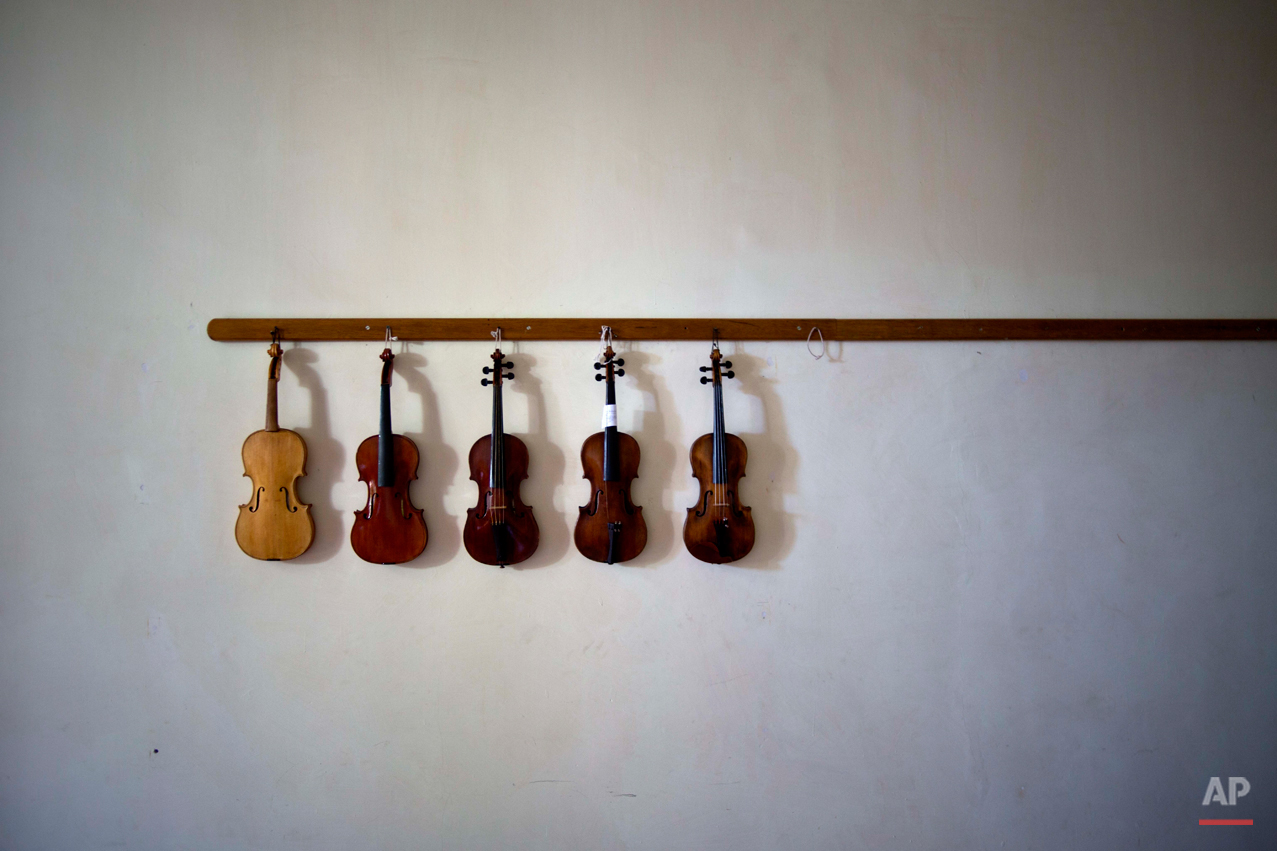 APTOPIX Cuba Violins Photo Gallery