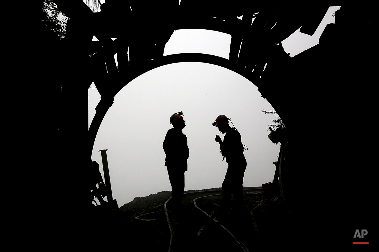 In this Thursday, May 8, 2014 photo, a coal miner lights a cigarette after a long of work at a mine near the city of Zirab 212 kilometers (132 miles) northeast of the capital Tehran, on a mountain in Mazandaran province northern Iran. Around 1,200 miners work across 10 mines in the Mazandaran province, in a mountainous, verdant area. More than 12,000 tons of coal is extracted from the mines each month, almost all of which is shipped south for use in Iran's steel industry. (AP Photo/Ebrahim Noroozi)