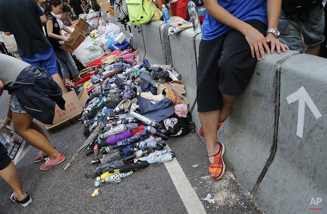Stacks of umbrellas are ready for pro-democracy protesters' use to shield themselves from pepper spray Monday, Sept. 29, 2014 in Hong Kong. Protesters expanded their rallies throughout Hong Kong on Monday, defying calls to disperse in a major pushback against Beijing's decision to limit democratic reforms in the Asian financial hub. (AP Photo/Wong Maye-E)