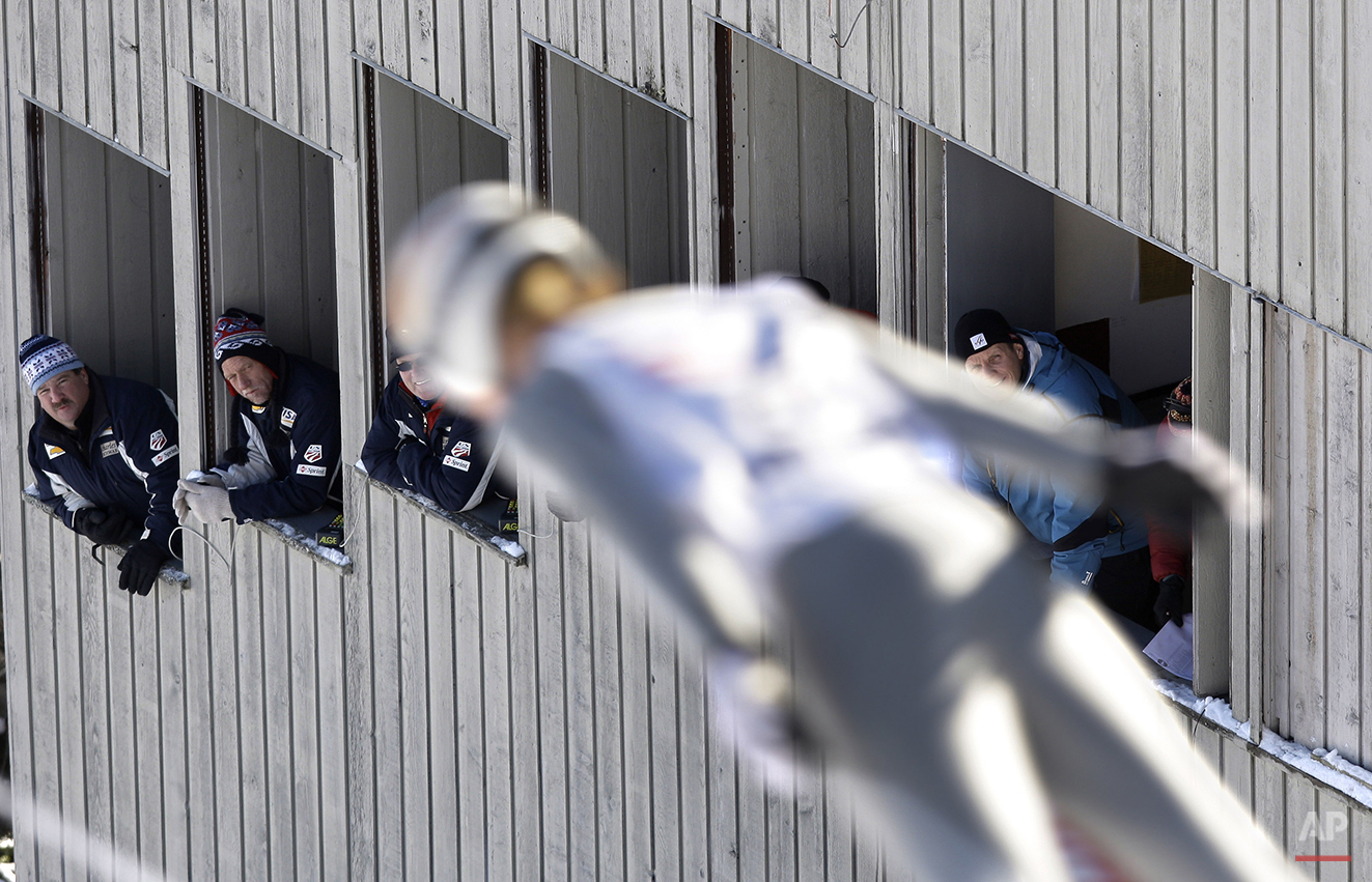 Judges watch as a competitor comes off the end of the ski jump during the Nordic Combined Intercontinental Cup ski jumping competition Saturday, Dec. 19, 2009, in Lake Placid, N.Y. (AP Photo/Julie Jacobson)