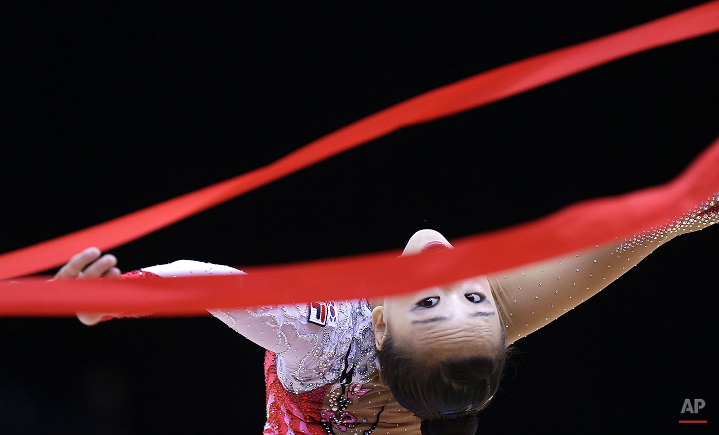South Korea's Son Yeon-jae performs during the rhythmic gymnastics individual all-around qualifications  at the 2012 Summer Olympics, Friday, Aug. 10, 2012, in London. (AP Photo/Julie Jacobson)