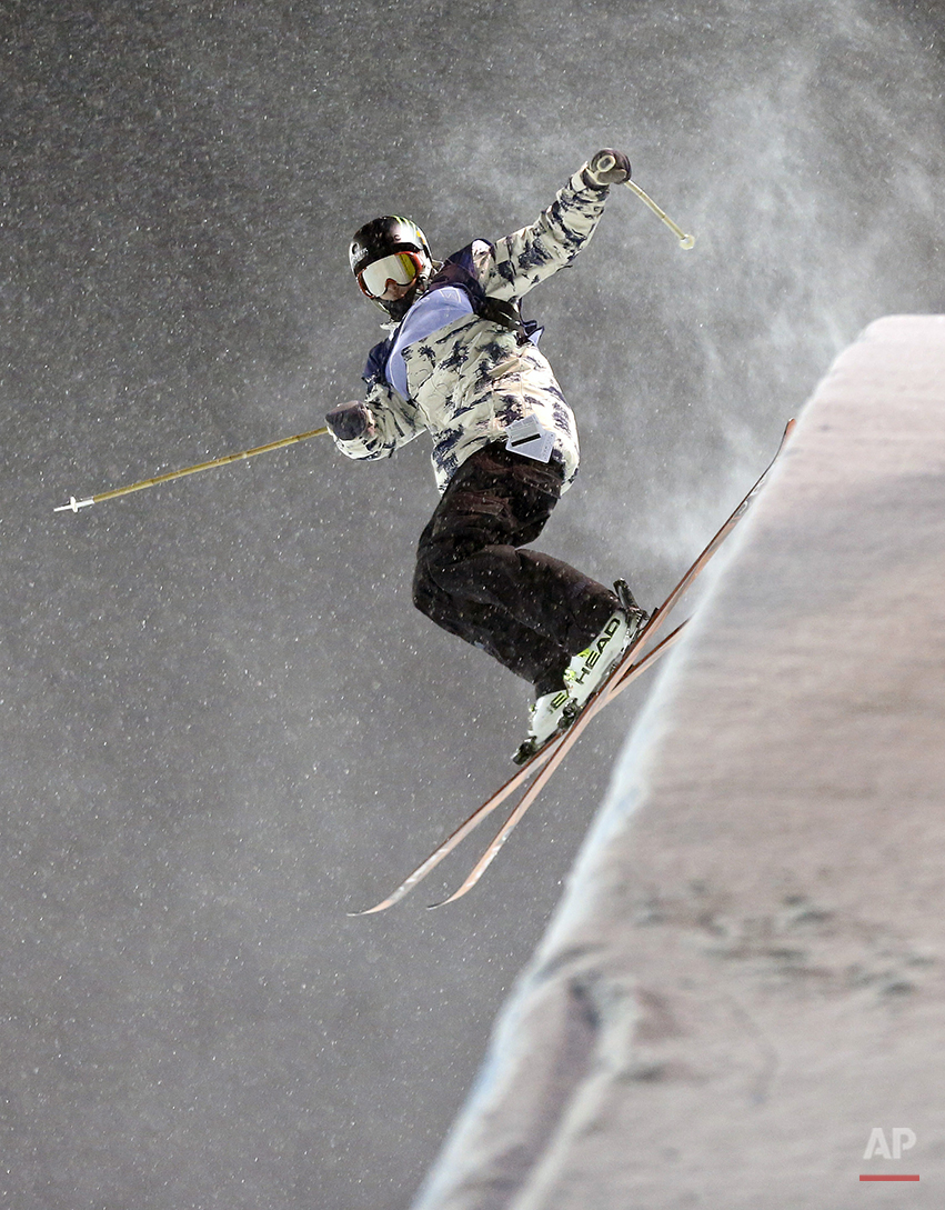 Aaron Blunck lands his last stunt during the World Cup U.S. Grand Prix halfpipe freestyle skiing finals on Friday, Dec. 20, 2013, in Frisco, Colo. Blunck won the event with a score of 92. (AP Photo/Julie Jacobson)