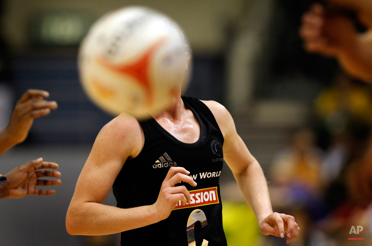 Laura Langman of New Zealand keeps a close watch on the ball while playing against Trinidad and Tobago during the third day of the Mission Foods World Netball Championships held on Wednesday July 6, 2011 in Singapore.(AP Photo/Wong Maye-E)