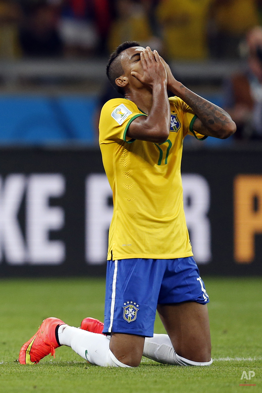 Brazil's Luiz Gustavo prays after the World Cup semifinal soccer match between Brazil and Germany at the Mineirao Stadium in Belo Horizonte, Brazil, Tuesday, July 8, 2014. Germany beat Brazil 7-1 and advanced to the final. (AP Photo/Frank Augstein)
