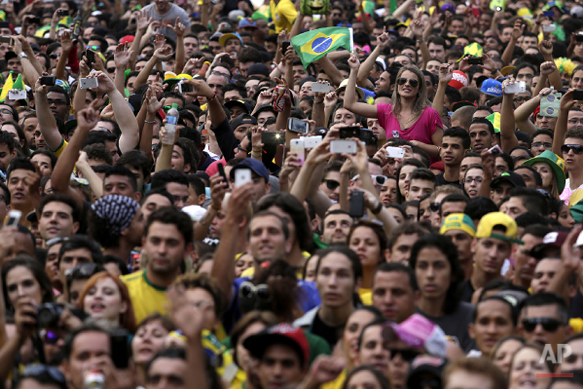 Brazil soccer fans watch their team's World Cup semifinal match with Germany via live telecast in Belo Horizonte, Brazil, Tuesday, July 8, 2014. (AP Photo/Bruno Magalhaes)
