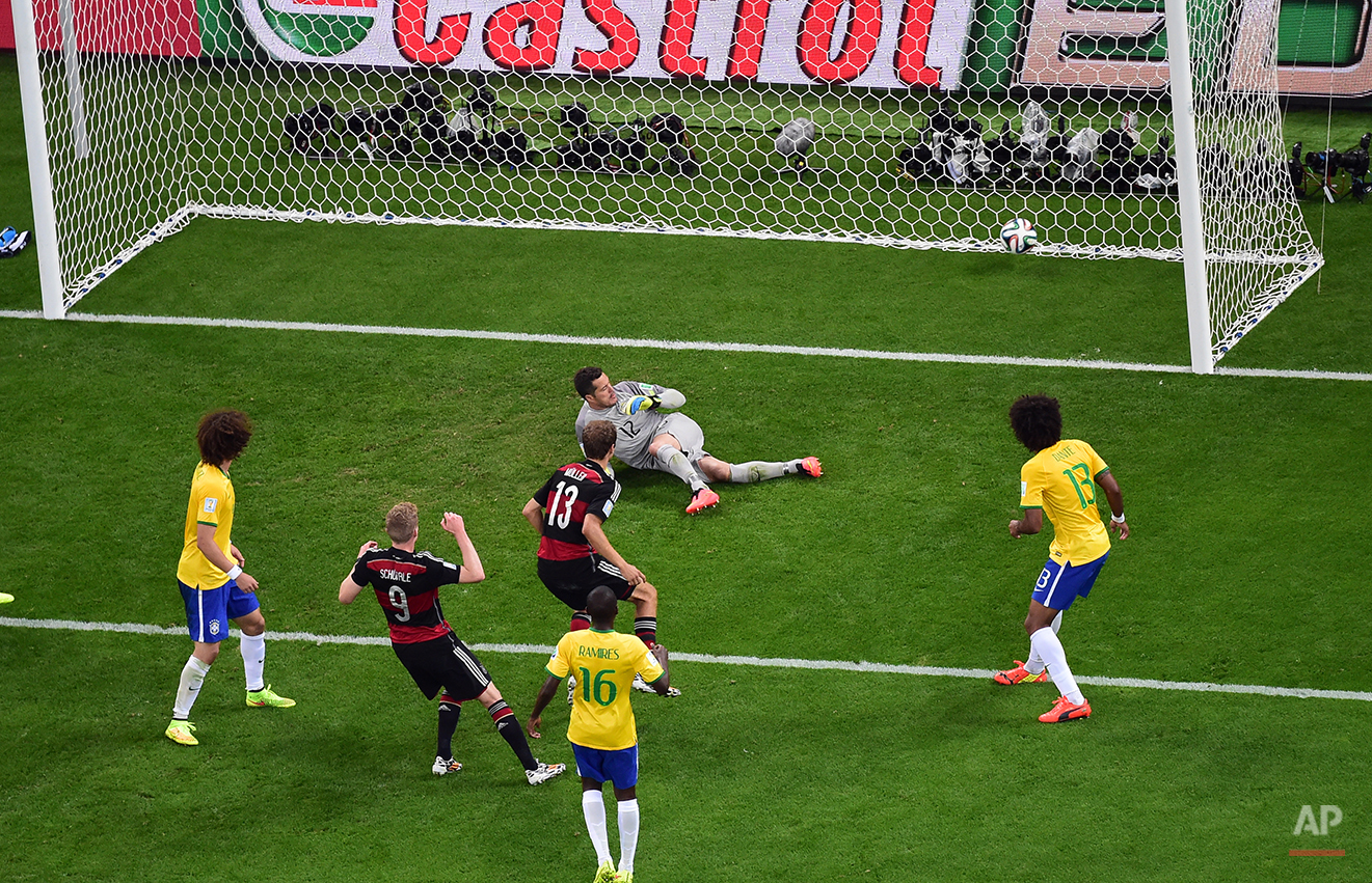 Germany's Andre Schuerrle, second left, scores his side's 6th goal during the World Cup semifinal soccer match between Brazil and Germany at the Mineirao Stadium in Belo Horizonte, Brazil, Tuesday, July 8, 2014. (AP Photo/Francois Xavier Marit, Pool)