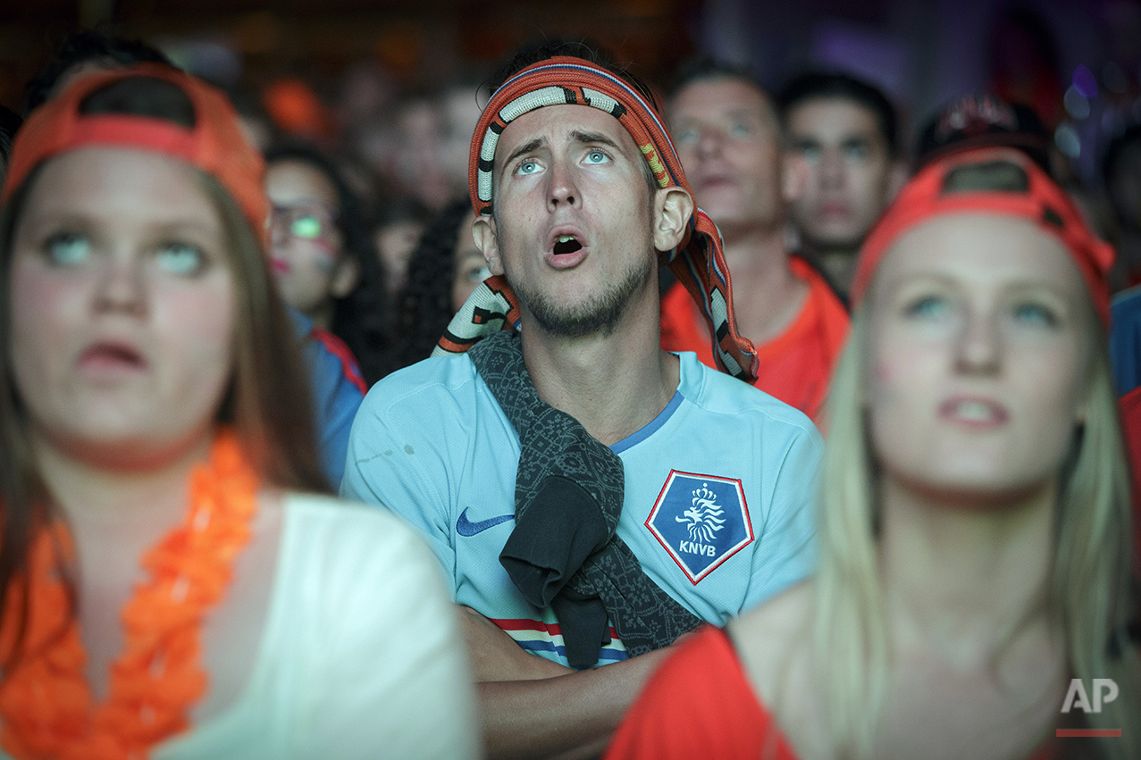 Soccer fans watch a live broadcast of the FIFA World Cup semifinal soccer match between Netherlands and Argentina on a giant screen in the center of Eindhoven, Netherlands, Wednesday, July 9, 2014. (AP Photo/Phil Nijhuis)