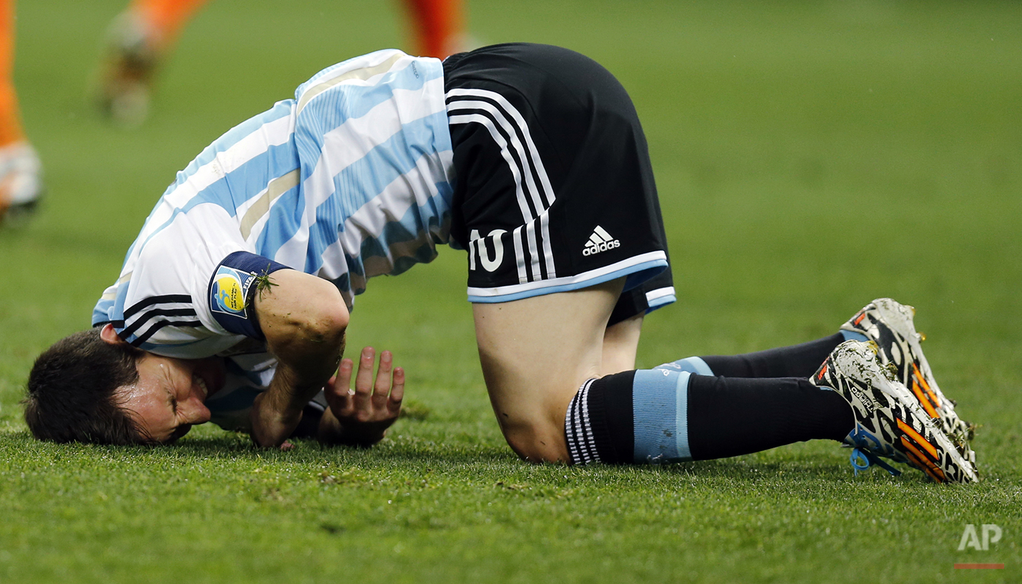 Argentina's Lionel Messi sits on the floor during the World Cup semifinal soccer match between the Netherlands and Argentina at the Itaquerao Stadium in Sao Paulo, Brazil, Wednesday, July 9, 2014. (AP Photo/Frank Augstein)