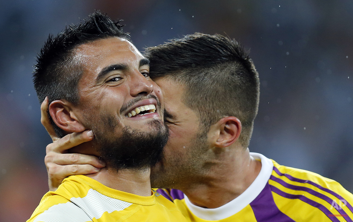 Argentina's goalkeeper Mariano Andujar, right, congratulates goalkeeper Sergio Romero after the World Cup semifinal soccer match between the Netherlands and Argentina at the Itaquerao Stadium in Sao Paulo, Brazil, Wednesday, July 9, 2014. Argentina beat the Netherlands 4-2 in a penalty shootout to reach the World Cup final. (AP Photo/Frank Augstein)