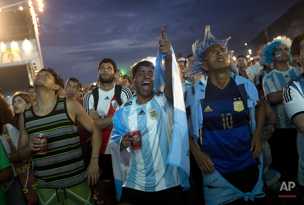 Argentina soccer fans watch a live broadcast of their team's World Cup semifinal match against Netherlands inside the FIFA Fan Fest area on Copacabana beach in Rio de Janeiro, Brazil, Wednesday, July 9, 2014. (AP Photo/Silvia Izquierdo)
