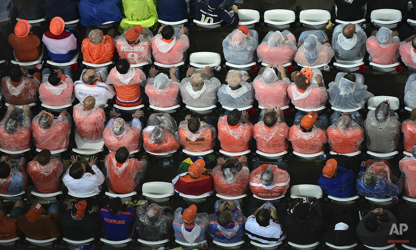 Dutch supporters watch from the stands during the World Cup semifinal soccer match between the Netherlands and Argentina at the Itaquerao Stadium in Sao Paulo, Brazil, Wednesday, July 9, 2014. (AP Photo/Francois Xavier Marit, Pool)