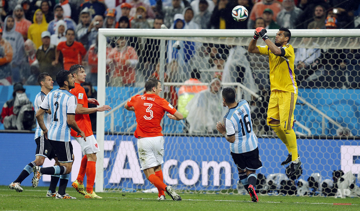 Argentina's goalkeeper Sergio Romero deflects a ball during the World Cup semifinal soccer match between the Netherlands and Argentina at the Itaquerao Stadium in Sao Paulo, Brazil, Wednesday, July 9, 2014. (AP Photo/Frank Augstein)
