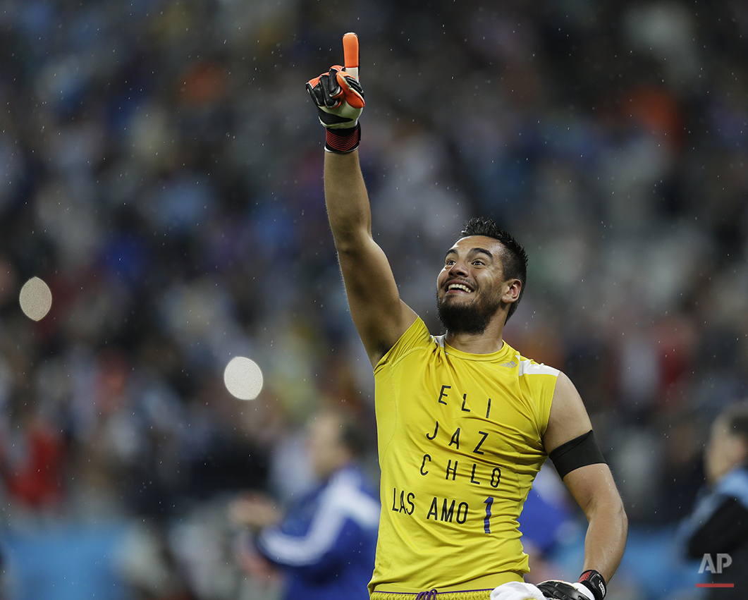Argentina's goalkeeper Sergio Romero celebrates after Argentina defeated the Netherlands 4-2 in a penalty shootout after a 0-0 tie after extra time to advance to the finals during the World Cup semifinal soccer match between the Netherlands and Argentina at the Itaquerao Stadium in Sao Paulo Brazil, Wednesday, July 9, 2014. (AP Photo/Natacha Pisarenko)