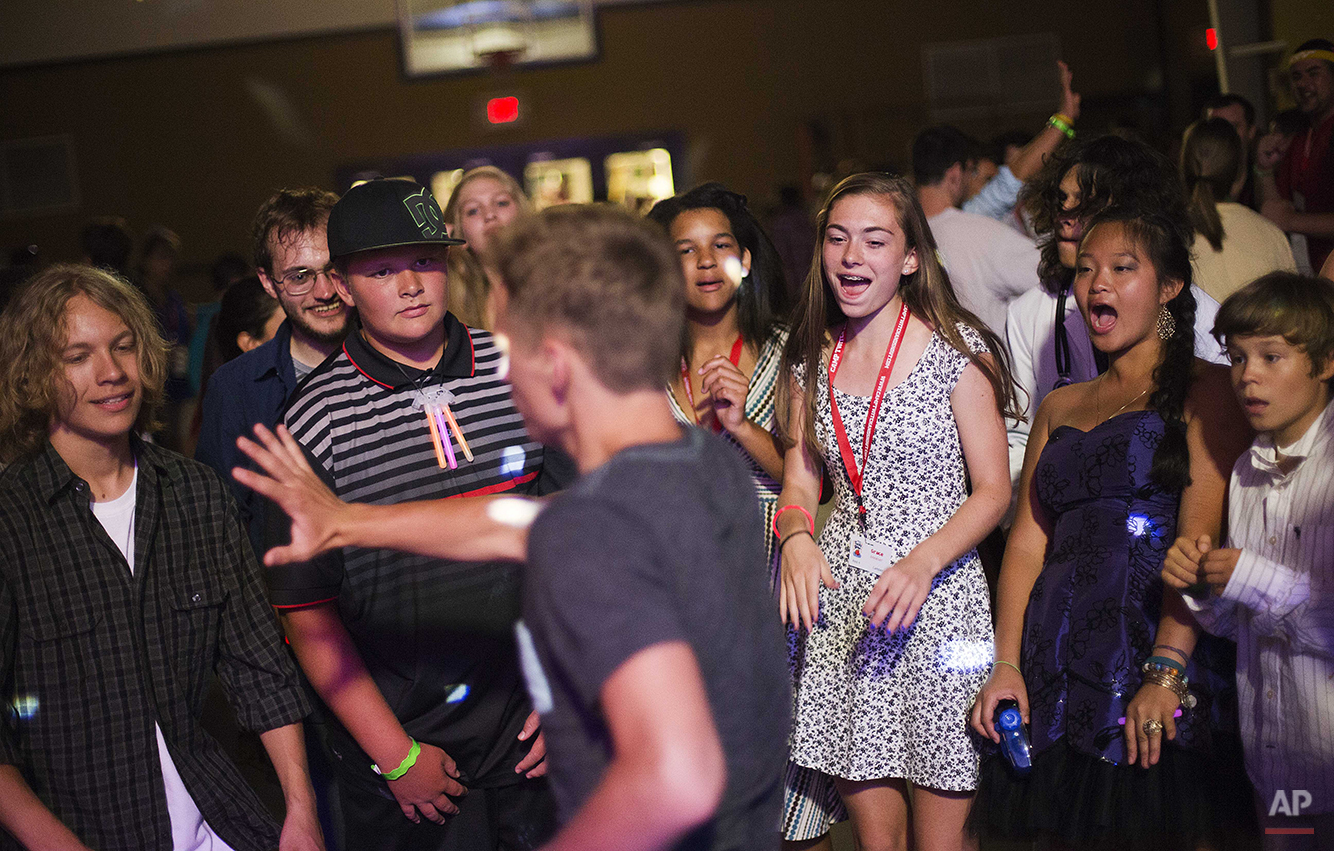 In this Thursday, July 17, 2014 photo, campers attend a dance on the final evening at Camp Twitch and Shout, a camp for children with Tourette's Syndrome in Winder, Ga. (AP Photo/David Goldman)