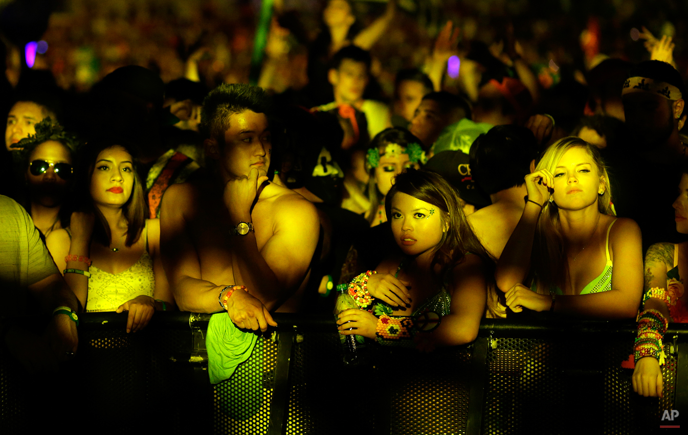 Festival goers relax during a lull in the music at the Electric Daisy Carnival, Saturday, June 21, 2014, in Las Vegas. (AP Photo/John Locher)