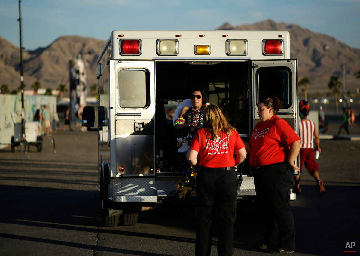 A woman is loaded in to an ambulance outside of the Las Vegas Motor Speedway on the first night of the Electric Daisy Carnival, Friday, June 20, 2014, in Las Vegas. Between Friday evening and Sunday morning, Las Vegas police reported 560 mostly minor medical calls, with 17 resulting in trips to the hospital. (AP Photo/John Locher)
