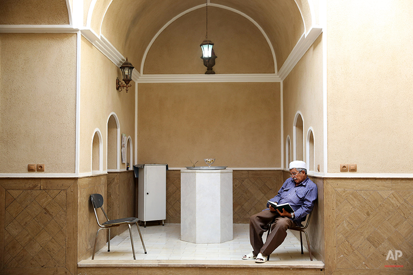 In this Saturday, June 14, 2014 photo, a Zoroastrian man prays in Setipir Shrine in Yazd about 405 miles (675 kilometers) southeast of the capital Tehran, Iran. Zoroastrianism is a monotheistic religion predating Christianity, Islam and Judaism, founded some 3,800 years ago by the prophet Zoroaster. It was the dominant religion in Persia before the Arab conquest. Thousands of Zoroastrians, like many other Iranians, immigrated abroad under former president Mahmoud Ahmadinejad because of social restrictions and a worsening economy. But now a dozen have returned to live in Iran this past year, the government said. (AP Photo/Ebrahim Noroozi)
