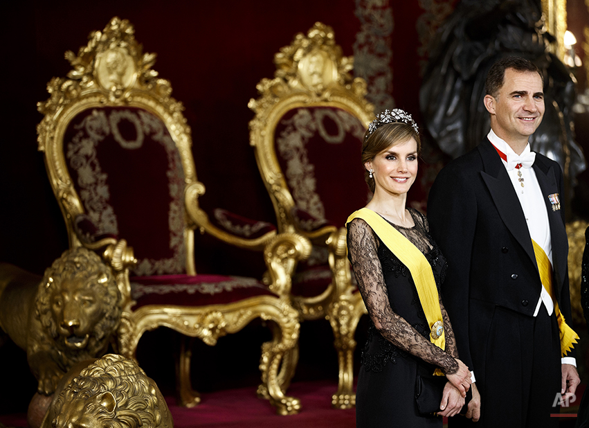 Spanish Princess Letizia and Spanish Crown Prince Felipe smile in the Throne room as they attend a welcome ceremony before a gala dinner for Mexico's President Enrique Pena Nieto, at the Royal Palace, near Madrid, Monday, June 9, 2014. King Juan Carlos plans to abdicate and pave the way for his son, Crown Prince Felipe, to become the country's next king. (AP Photo/Daniel Ochoa de Olza, pool)
