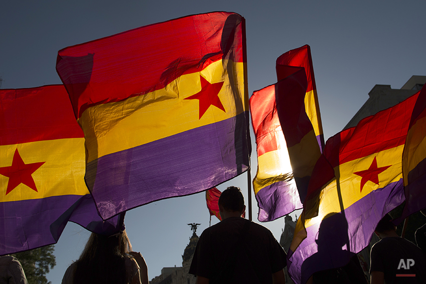 Protestors march as they wave Republican flags during a demonstration against the Spanish Monarchy and demanding a referendum in Madrid, Spain, Saturday, June 7, 2014. King Juan Carlos plans to abdicate and pave the way for his son, Crown Prince Felipe, to become the country's next king. The 76-year-old Juan Carlos oversaw his country's transition from dictatorship to democracy but has had repeated health problems in recent years, and his popularity dipped following royal scandals. (AP Photo/Andres Kudacki)