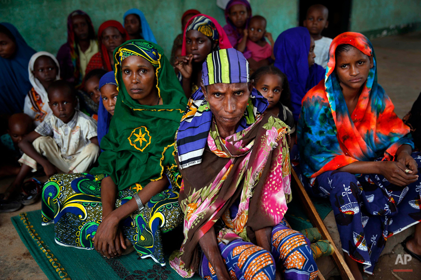Peul women sit in a house across the Nour Islam mosque where they found refuge in Bangui, Central African Republic, Wednesday, Dec. 11, 2013. More than 500 people have been killed over the past week in sectarian fighting in Central African Republic, aid officials said Tuesday, as France reported that gunmen fatally shot two of its soldiers who were part of the intervention to disarm thousands of rebels accused of attacking civilians.(AP Photo/Jerome Delay)
