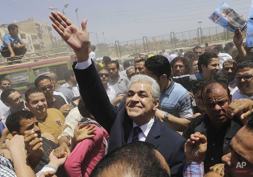Presidential hopeful Hamdeen Sabahi waves to his supporters in Baltim city, 212 kilometers (132 miles) North of Cairo, Egypt, Friday, May 16, 2014. With only two people - former army chief Abdel-Fattah el-Sissi and leftist politician Hamdeen Sabahi - vying for the country's top post, the Egyptian election commission set the first round of voting for May 26 and 27, with results expected by June 5. (AP Photo/Amr Nabil)