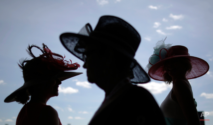 Women make their way to the grandstand before the 140th running of the Kentucky Derby horse race at Churchill Downs Saturday, May 3, 2014, in Louisville, Ky. (AP Photo/David Goldman)