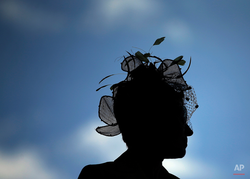 A woman looks out over a balcony before the 140th running of the Kentucky Derby horse race at Churchill Downs Saturday, May 3, 2014, in Louisville, Ky. (AP Photo/Matt Slocum)