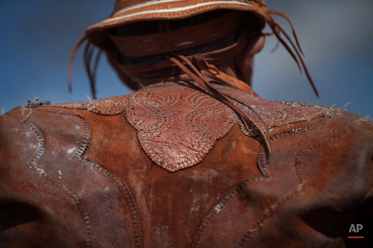 """In this July 24, 2015 photo, a cowboy wears his traditional """"gibao"""" suit at the annual Catch the Bull event known as """"Pega do Boi"""" in Serrita, in Brazil's Pernambuco state. Brazilian cowboys, known as """"vaqueros,"""" make their own protective clothing from leather or buy a tailor-made """"gibao"""" from a local artisan, shelling out about $200 dollars. (AP Photo/Eraldo Peres)"""