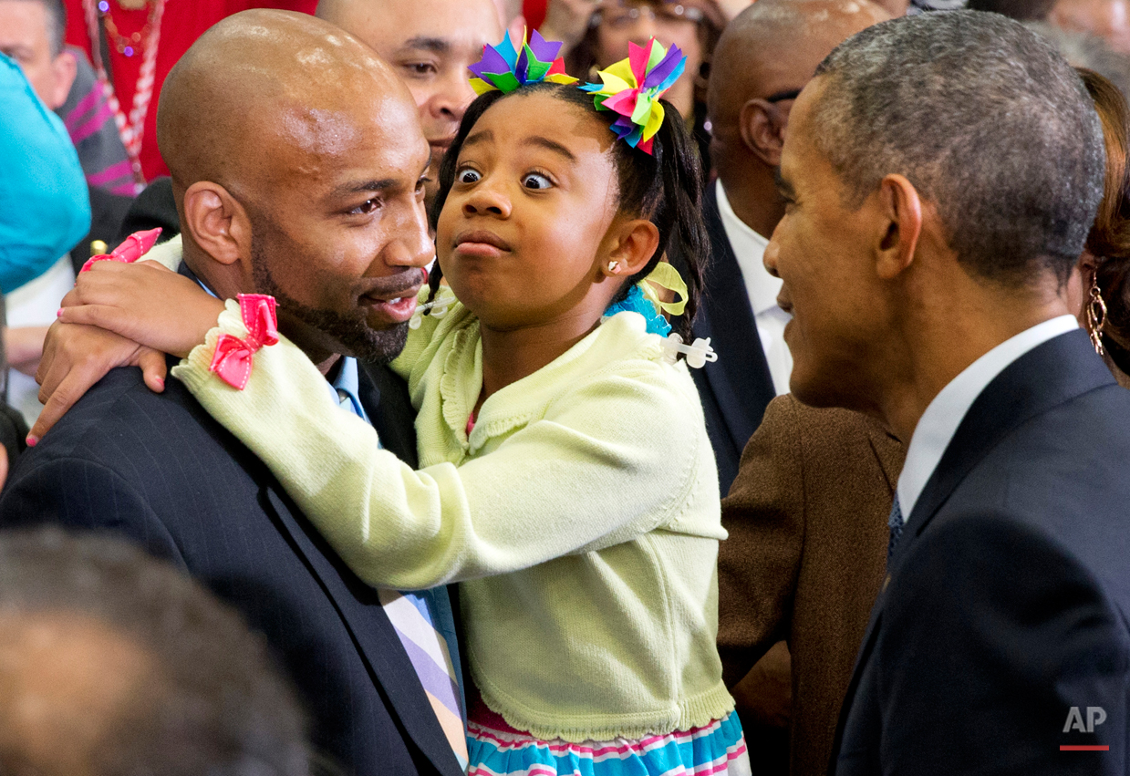 A girl reacts as President Barack Obama greets her and others in the crowd after speaking about payday lending, at Lawson State Community College in Birmingham, Ala., Thursday, March 26, 2015. (AP Photo/Jacquelyn Martin)