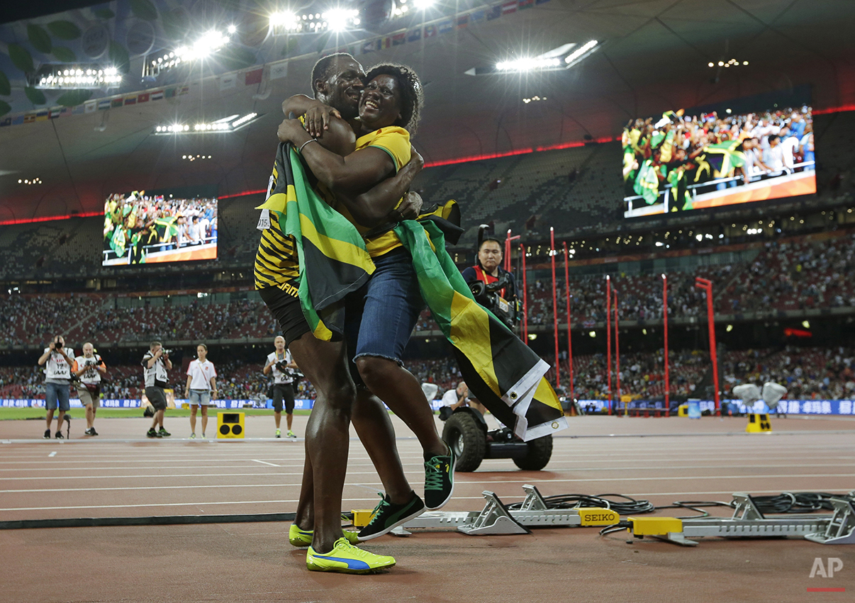 Jamaica's Usain Bolt hugs his mom, Jennifer Bolt, after winning the men's 100m final at theWorld Athletics Championships at the Bird's Nest stadium in Beijing, Sunday, Aug. 23, 2015. (AP Photo/David J. Phillip)