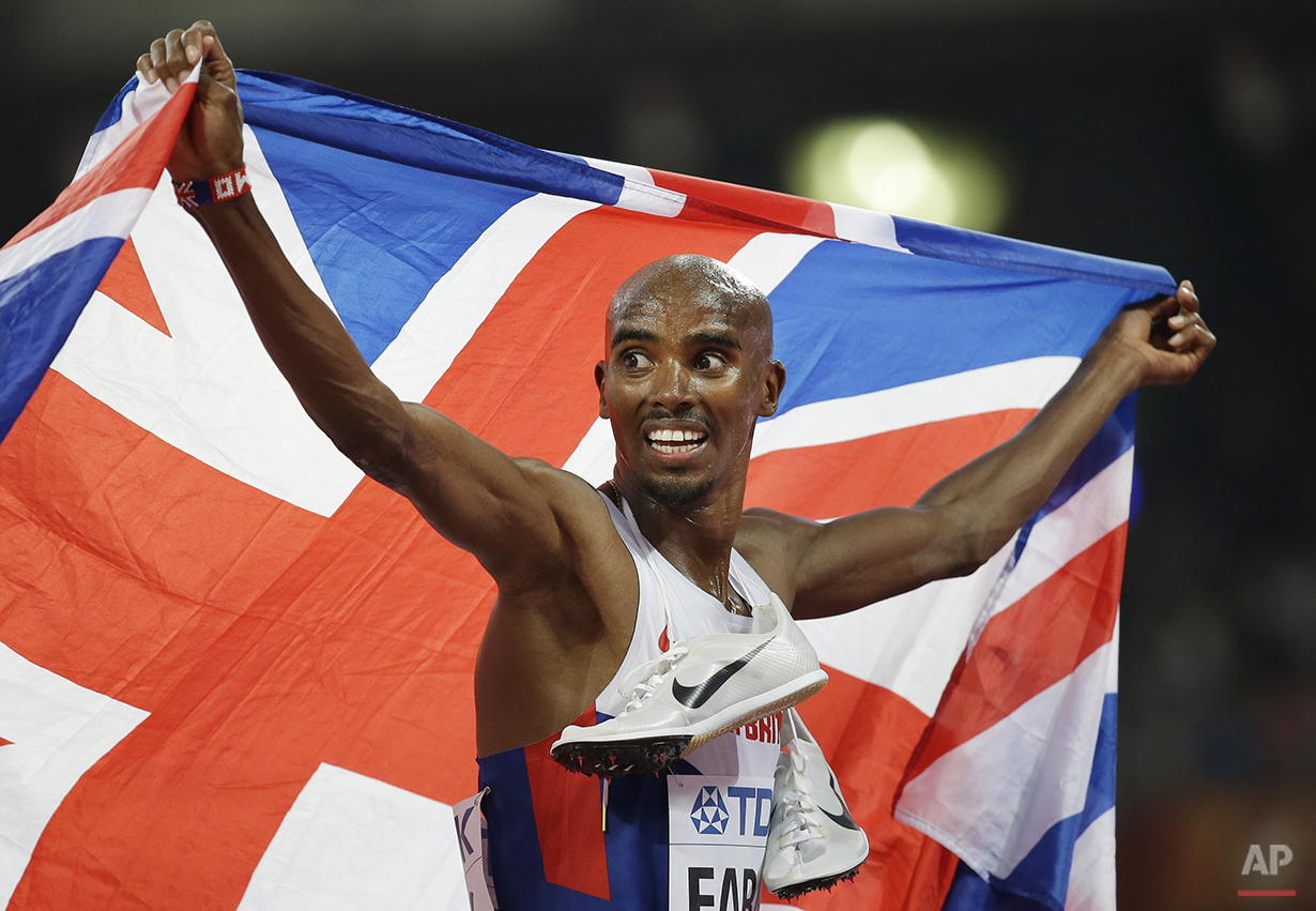Britain's Mo Farah celebrates winning the men's 5000m final at the World Athletics Championships at the Bird's Nest stadium in Beijing, Saturday, Aug. 29, 2015. (AP Photo/David J. Phillip)